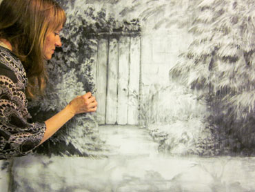 Jo Sheppard working on a charcoal drawing by Jo Sheppard