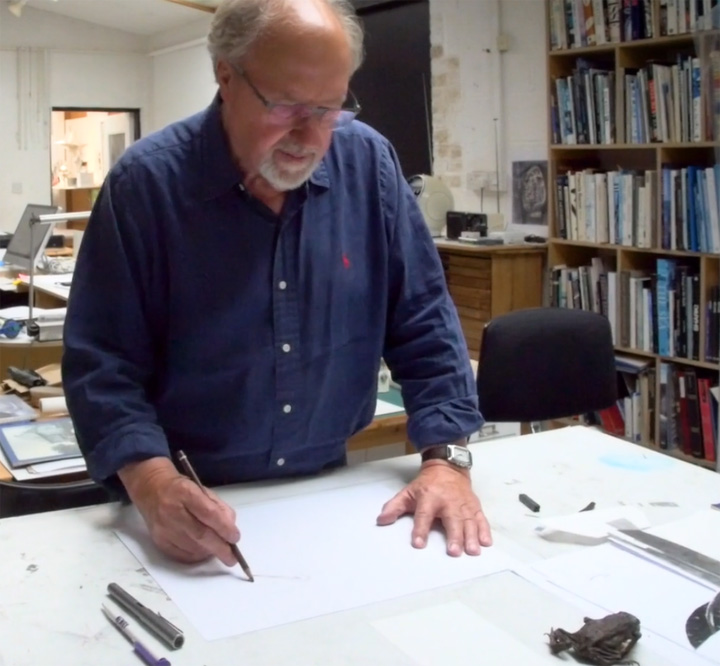 Photograph of John Sydney Carter drawing