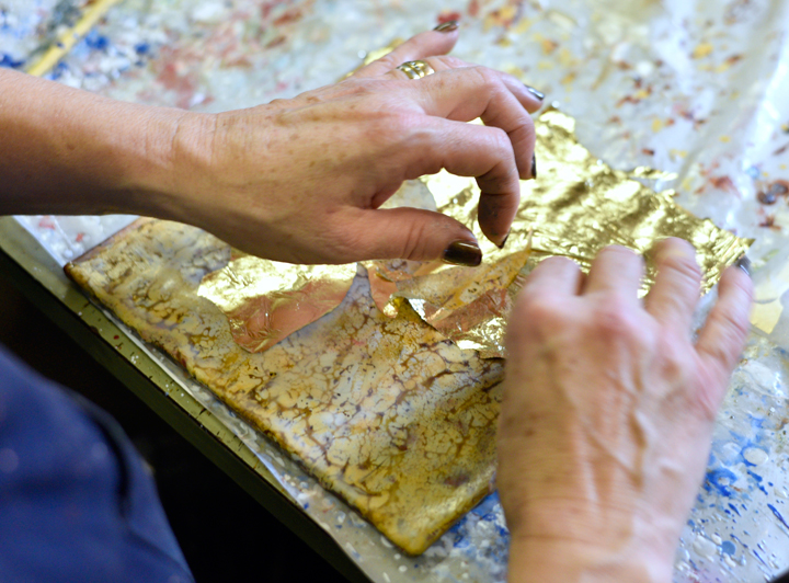 Jo applying gold leaf