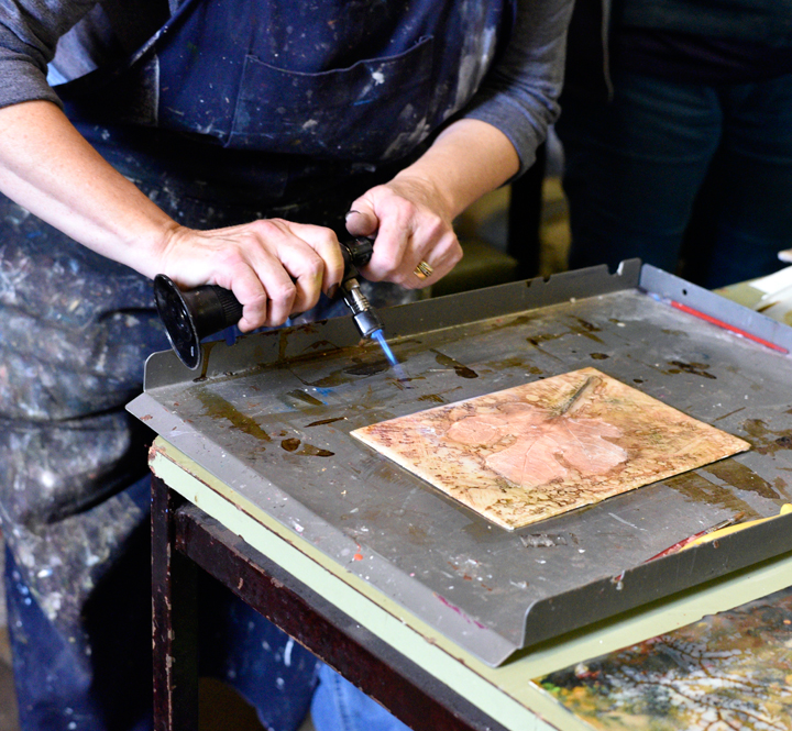 Jo using a blow torch on encaustic painting