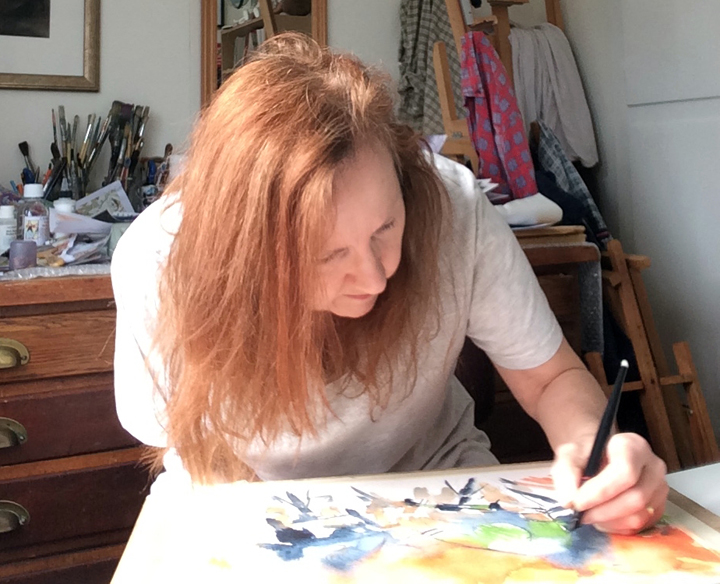 Maxine Dodd painting in her studio