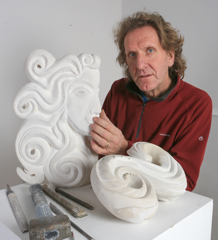Photograph of Michael Moralee with sculpture