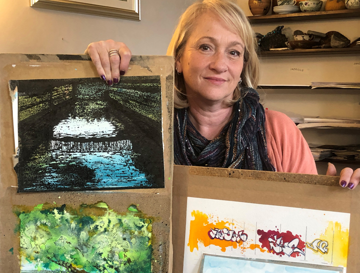 artist Jo Sheppard with examples of gouache washoff paintings