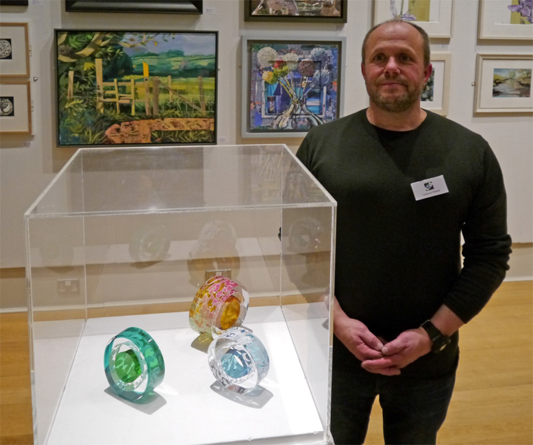 Graeme Hawes with his three glass pieces