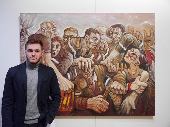 Samson Tudor infront of his award winning painting