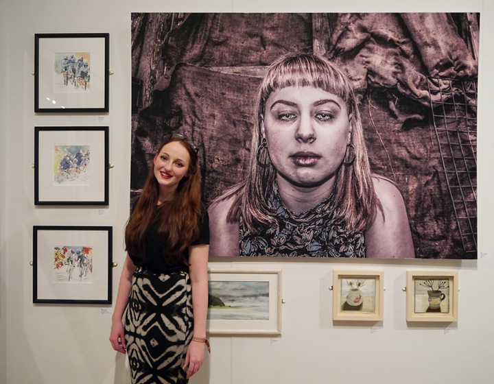 Tiffany Tangen in front of her prize winning photograph