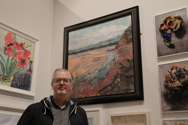 Thumbnail image of Alan Hopwood in front of 'Low Tide across St Austell Bay' - LSA Annual Exhibition 2017
