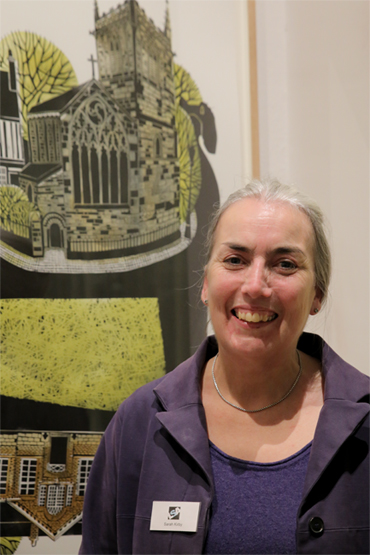 Thumbnail image of Sarah Kirby in front of 'St Mary de Castro and Castle Yard', linocut - LSA Annual Exhibition 2017