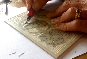 Photogrph of cutting a lino block
