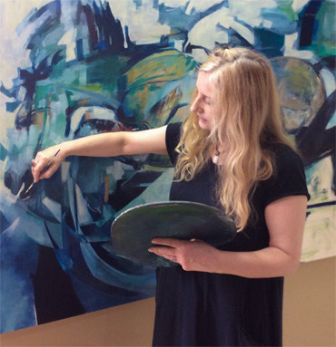 Photograph of Louise Ellerington painting