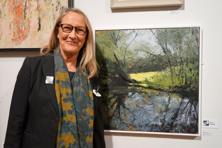 Lisa Timmerman with her winning oil painting