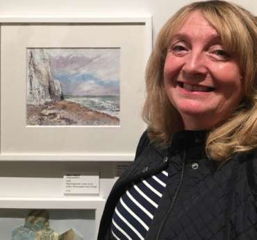 Thumbnail image of Sue Graham with her work at The Open Exhibition - The Open Exhibition