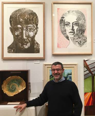 Thumbnail image of George Sfougaras with his work at The Open Exhibition - The Open Exhibition