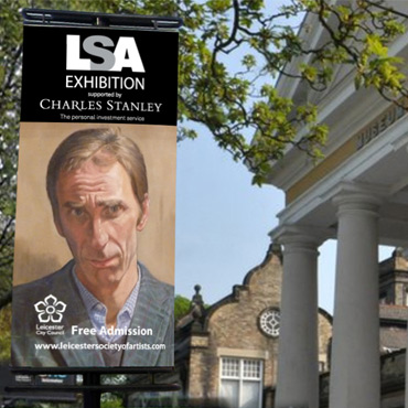 photo outside museum with LSA exhibition banner