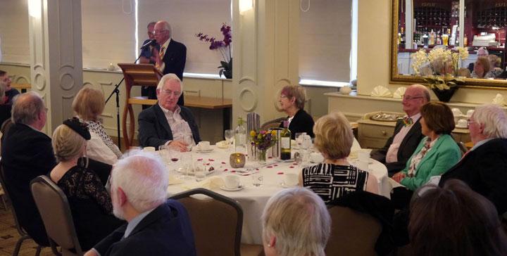 Painter Bryan Organ speaks at the dinner