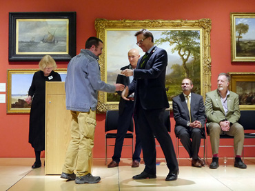 Thumbnail image of Chris Hailes of sponsors Charles Stanley presenting the prize toCharles Stanley BronzePrize winnerDylan Waldron - Preview Evening: LSA Annual Exhibition 2016