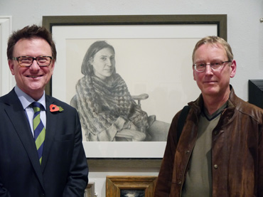 Thumbnail image of Chris Hailes of exhibition sponsors Charles Stanley with Andrew Jackson, winner of the Charles Stanley Silver Awardin front of 'Johti' - Preview Evening: LSA Annual Exhibition 2016