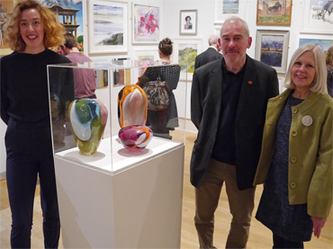 Thumbnail image of Alice Heaton with her prize-winning glass pieces and Marck Geary and Gillian Geary of Student Award sponsors West End Gallery - Preview Evening: LSA Annual Exhibition 2016