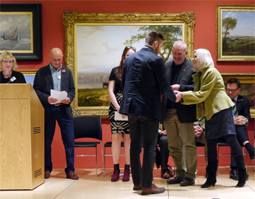 Thumbnail image of Student Award Winner Samson Tudor receiving his prize from sponsors Marck and Gillian Geary of West End Gallery - Preview Evening: LSA Annual Exhibition 2016