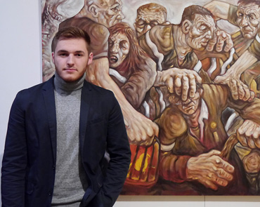 Thumbnail image of Samson Tudor, LSA Student Award Winner, infront of 'Land of Lost Content' - Preview Evening: LSA Annual Exhibition 2016