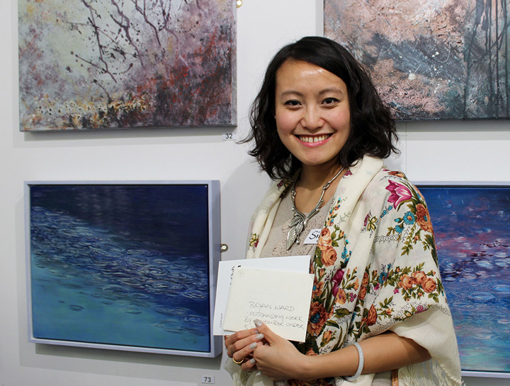 Siyuan Ren with her painting