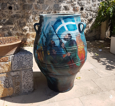 Thumbnail image of One of two painted urns by George Sfougaras in Potamies - Art Abroad - George Sfougaras Paints In Potamies