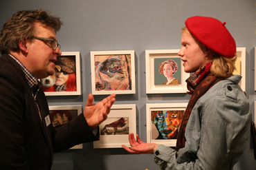 Thumbnail image of Lars Tharp with Becky Hayley (Oakham School student) in front of her prizewinning painting 'The Red Scarf' - Little Selves - Preview Photographs