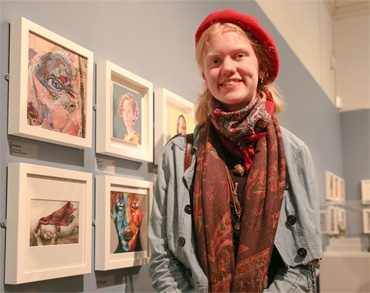 Thumbnail image of Becky Hayley (Oakham School student) in front of her prizewinning work 'The Red Scarf' - Little Selves - Preview Photographs