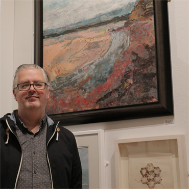 Thumbnail image of LSA member Alan Hopwood in front of his picture 'Low Tide Across St Austell Bay', which won the LSA Chair's Prize - LSA Annual Exhibition 2017 Preview Evening