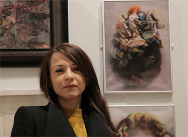 Thumbnail image of Stefania Laccu, LSA Student Award 2017 runner up at the preview of LSA Annual Exhibition 2017 in front of her triptych 'Psychosomatic Skin Series' - Preview Evening: LSA Annual Exhibition 2017