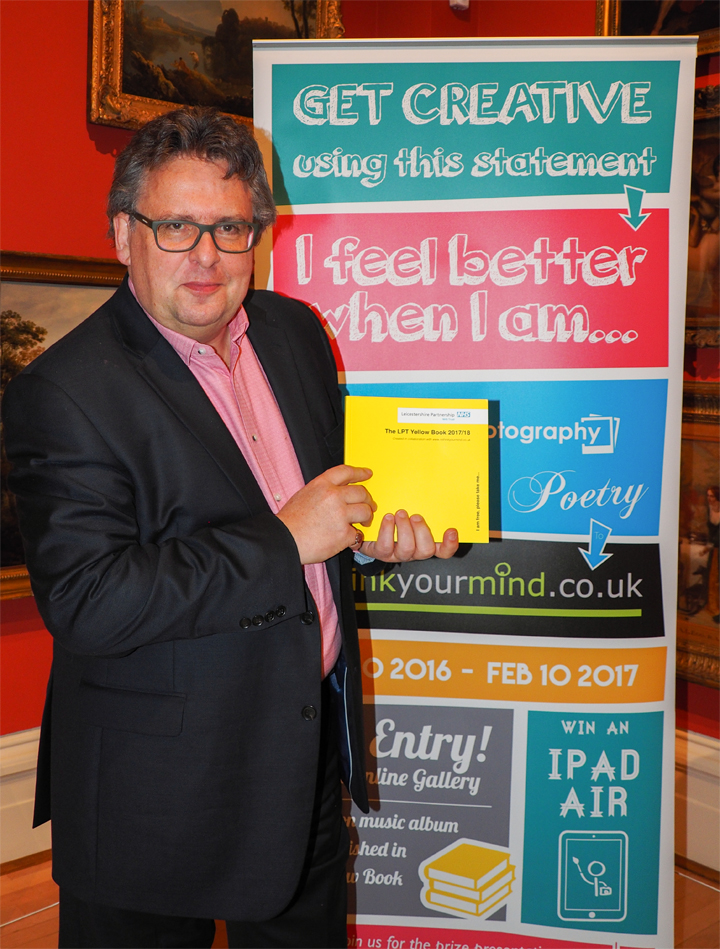 Lars Tharp with Rethink Your Mind poster