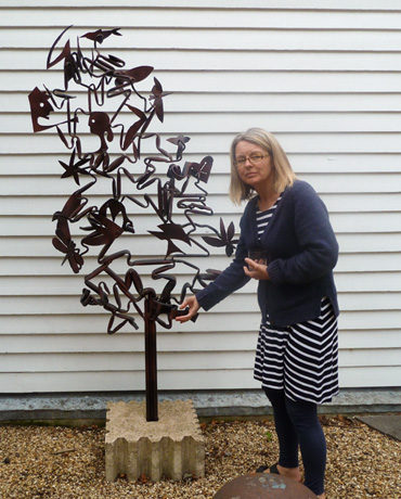 Thumbnail image of LSA member Danielle Vaughan with sculpture by John Sydney Carter - We Explore The Studio Of John Sydney Carter