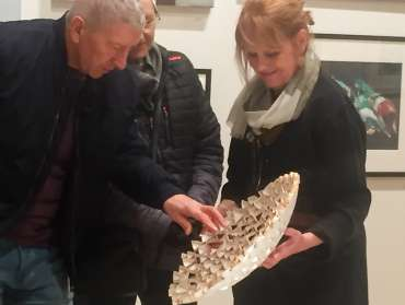 Thumbnail image of Deborah Bird with visitor demonstrating how the paper sculpture is constructed - Meet the LSA Artists at New Walk Museum!