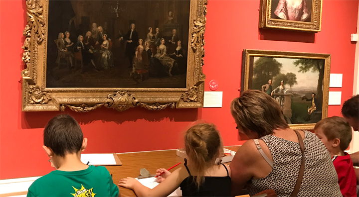visitors drawing the Hogarth at New Walk Museum